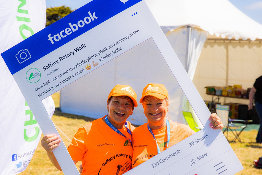 Saffery Rotary Walk walkers take their Saffery Selfie with the new 3D Facebook-themed frames